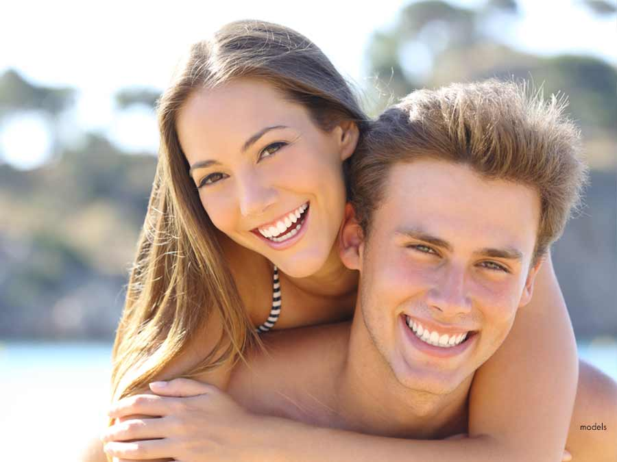 Young couple with beautiful straight teeth